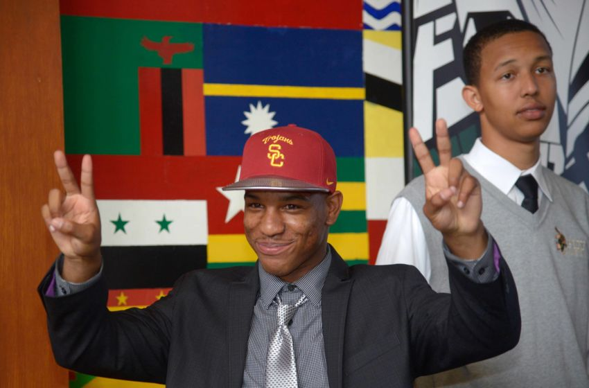 Feb 4, 2015; Long Beach, CA, USA; Long Beach Poly High Jackrabbits cornerback Iman Marshall (left) poses wtih basketball player Jordan Dallas after announcing his decision to attend the University of Southern California at press conference at Long Beach Poly. Mandatory Credit: Kirby Lee-USA TODAY Sports